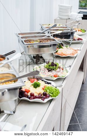 Buffet table with catering food in restaurant
