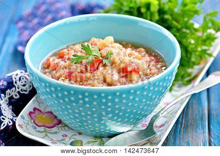 Baba ganoush salad with eggplant, tomato, onion, olive oil and sea salt.