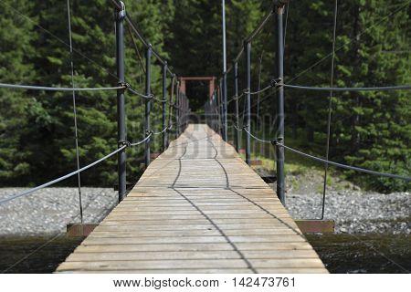 Suspension bridge over a stream in the North of Norway.