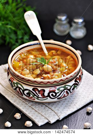 Moroccan harira soup in traditional bowls. soup