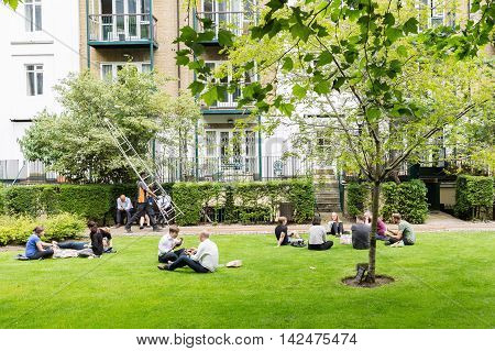 London UK - June 21 2016: unidentified people having lunchhour outdoors in London. London is one of the most important cultural finance and trade cities of the world.