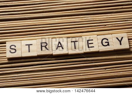 Strategy word on wooden cubes, success in business concept