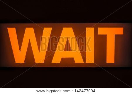 The Glowing Orange Wait Sign At A Uk Pedestrian Crossing