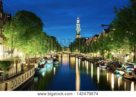 Westerkerk church tower at canal in  Amsterdam, Netherlands