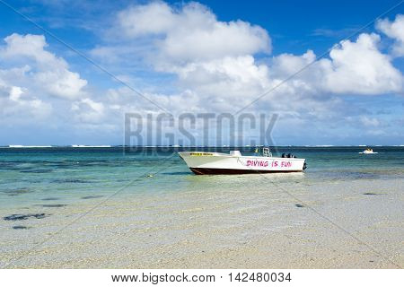 BEL OMBRE, MAURITIUS ISLAND - JUNE 16, 2016: Diving boats in Bel Ombre rocky beach, Mauritius island, June 16, 2016