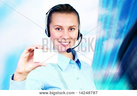 Happiness businesswoman speak in headphones on blur business architecture background