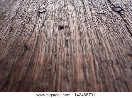 Texture surface of old wooden board and nail