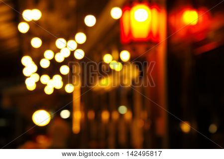 blur lamp light in the street corner of bar background
