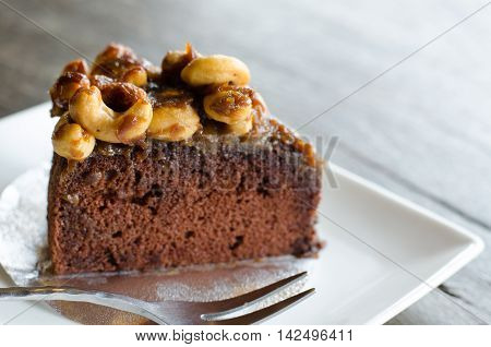 Toffee cake on white plate, close up