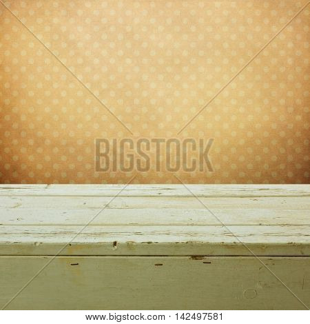 Easter holiday background with empty wooden table over retro wallpaper
