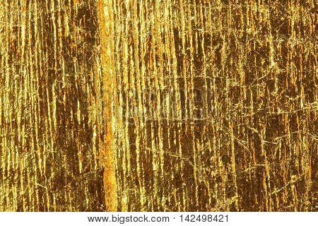 Shiny yellow leaf dark gold foil texture background