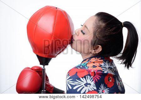 asian boxing woman kiss red punching bag