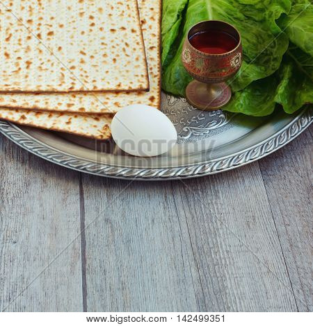 Jewish Passover seder celebration with egg, matzos and wine