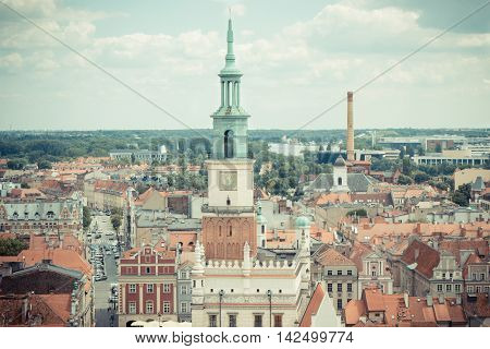 Poznan Poland - June 28 2016: Vintage photo View from tower on town hall old and modern buildings in polish city Poznan Greater Poland province