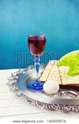 Jewish Passover holiday celebration with wine and matzos