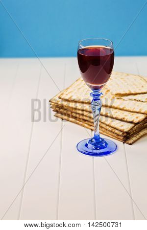 Background for Jewish Holiday Passover with wine and matzos