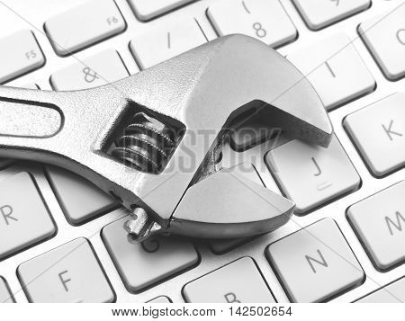 It support, laptop keypad with forceps or work tool.
