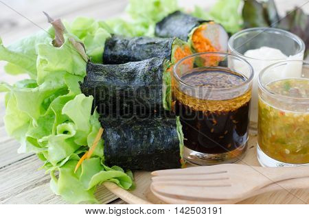 seaweed with tuna and imitation crab stick salad rolls with spicy sauce
