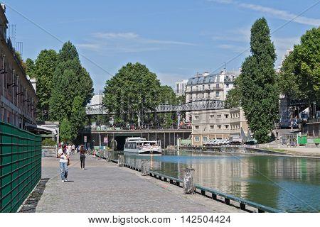PARIS, FRANCE-AUGUST 7, 2016: Tourist boat on the canal saint martin in Paris