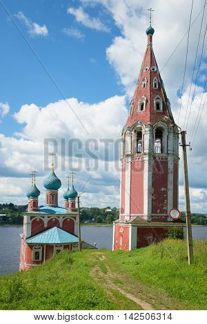 At the old church of Our Lady Mother of Kazan on the Volga river july afternoon. Tutayev Russia