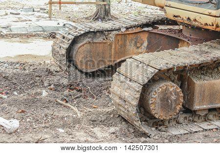 caterpillar of the excavator. Working outdoor Construction heavy equipment Large rusty in big industrial