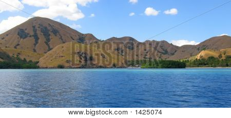 Yellow Mountains Falling On The Sea Of Komodo Archipelago, Indonesia, Panorama
