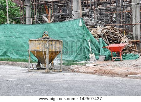 Concrete mixer container at construction site .