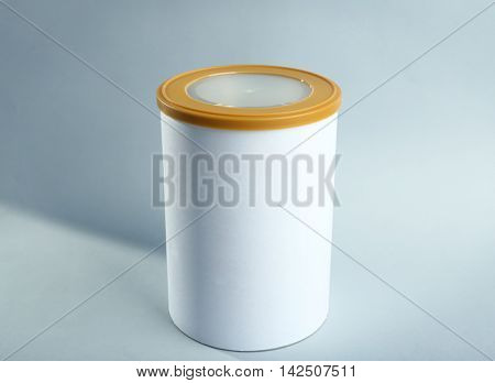 Baby milk formula in can on light background