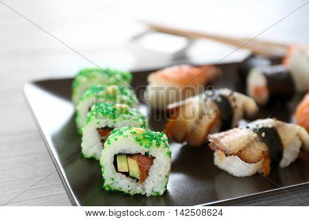 Delicious sushi set on ceramic plate