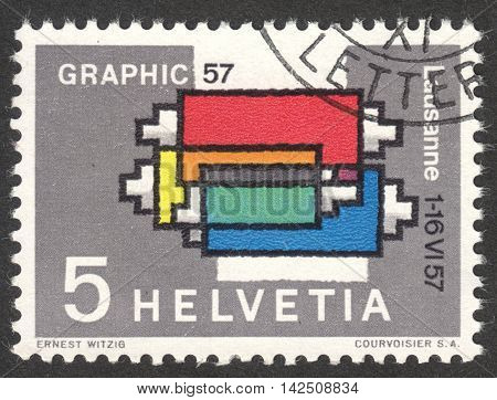 MOSCOW RUSSIA - CIRCA APRIL 2016: a post stamp printed in SWITZERLAND dedicated to the International Exhibition of Graphic Arts Lausanne circa 1957
