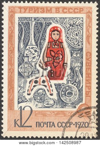 MOSCOW RUSSIA - CIRCA APRIL 2016: a post stamp printed in the USSR shows a matryoshka toy the series