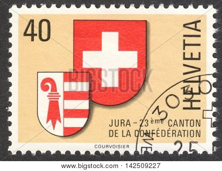MOSCOW RUSSIA - CIRCA APRIL 2016: a post stamp printed in SWITZERLAND shows coat of arms of Jura canton circa 1978