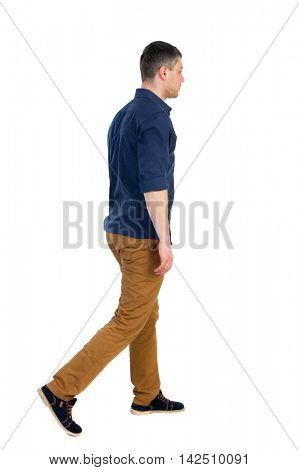 Back view of going  handsome man. walking young guy . Rear view people collection.  backside view of person.  Isolated over white background. a man in a blue shirt with the sleeves rolled up, sad is