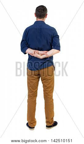 Back view of man . Standing young guy. Rear view people collection.  backside view of person.  Isolated over white background. a man in a blue shirt with the sleeves rolled up, standing with hands
