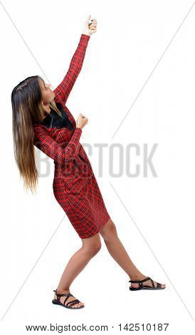 back view of standing girl pulling a rope from the top or cling to something. girl  watching. Rear view people collection.  backside view of person.  Isolated over white background. The girl in red