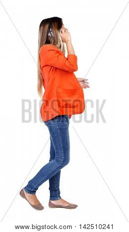 side view of a woman walking with a mobile phone. back view of girl in motion.  backside view of person.  Rear view people collection. Isolated over white background. girl in a red jacket goes to the