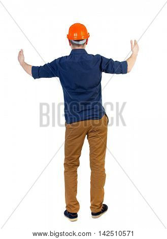Back view of builder in helmet shows thumbs up.   Rear view people collection.  backside view of person.  Isolated over white background. The engineer in a blue shirt with the sleeves rolled up and a