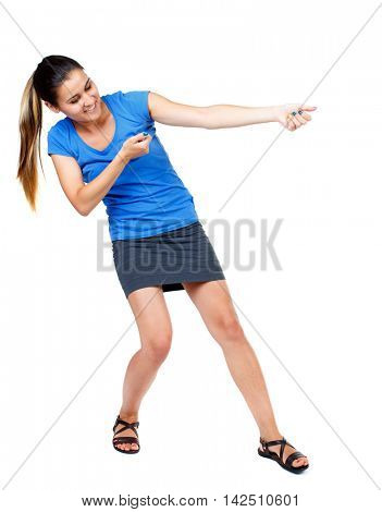 back view of standing girl pulling a rope from the top or cling to something. girl  watching. Rear view people collection.  backside view of person.  Isolated over white background. girl in a short