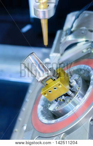 Edm Machine Handles Hole In Turbine Blade.