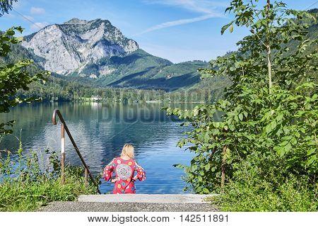 Woman On A Stairway To Lake Langbathsee In Austria, Salzkammgut