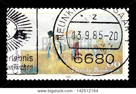 GERMANY - CIRCA 1985 . Cancelled postage stamp printed by Germany, that shows painting by Carl Spitzweg.