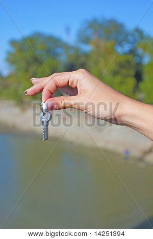 The girl throws keys