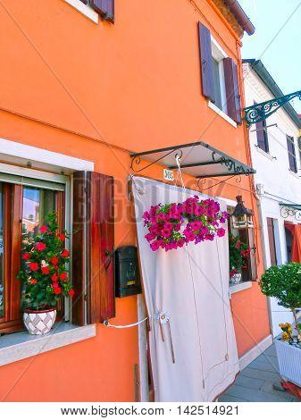 Burano Venice Italy - May 10 2014: Colorful old houses on the Island of Burano near Venice Italy