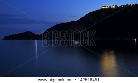 silhouette of a mountain chain on the island corfu in the mediterranean sea takken with bulb exposure by night