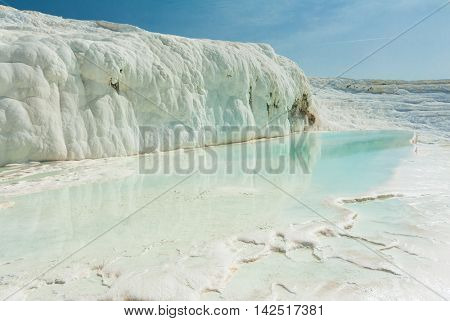 Blue pools and white travertine terraces at Pamukkale, Turkey