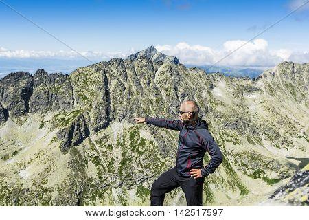 Tourist Indicates The Ridge.