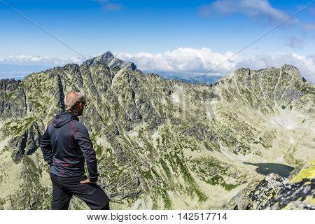 Hiker Watch The Raw Mountain Landscape.