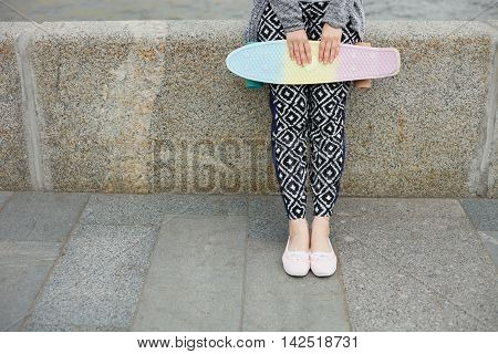 Girl In Boho Clothes Holding Cruiser Skateboard