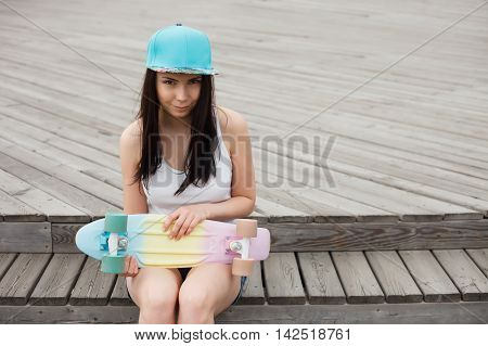 Young Girl With Short Cruiser Skateboard Deck Outdoors