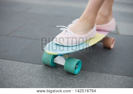 Feet Of Girl Riding Colorful Short Cruiser Skateboard